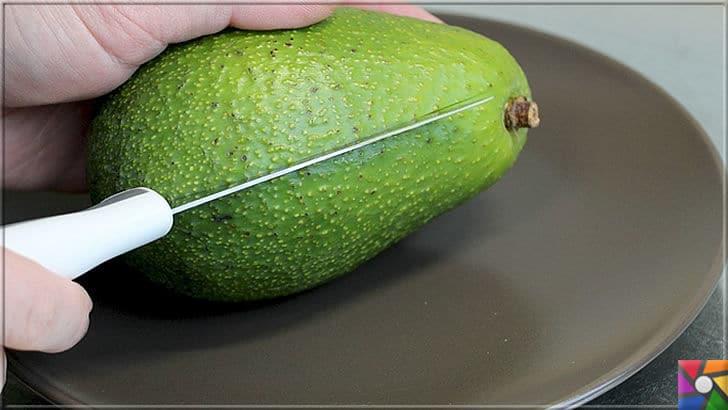 Neden Avokado yemeliyiz? Süper besin Avokadonun faydaları nelerdir? | Süper besin Avokadoyu dikine kesin ve elinizle ortadan ikiye bölün